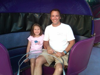 Kaitlyn and me on the Tilt-a-Whirl, our favorite ride at Wonderland Pier, in 2011
