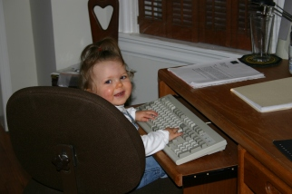 Kaitlyn playing in the home office in 2006